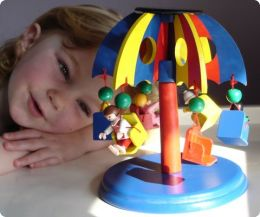 Solar powered revolving wooden carousel